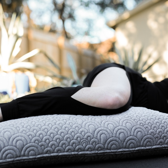 savasana side lying bolster